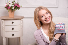 Young attractive woman holding baby hat , interior Stock Images