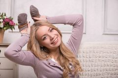 Young attractive woman holding baby mittens, Royalty Free Stock Images