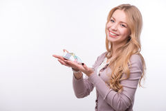 Young attractive woman holding baby shoe isolated Stock Photos