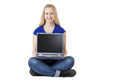 Young, attractive woman holding computer laptop Royalty Free Stock Photos