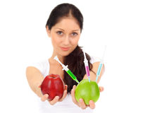 Young attractive woman holding GMO apple Stock Image