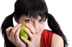 Young attractive woman holding green apple Royalty Free Stock Photo