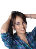 Young attractive woman holding hair and smiling Royalty Free Stock Photography