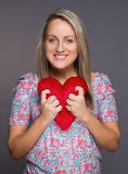 Young attractive woman holding heart in her hands Stock Photos