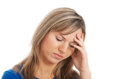 Young attractive woman holding her head, worrying. Stock Photos