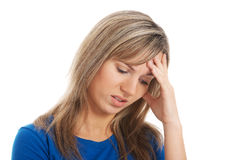 Young attractive woman holding her head, worrying. Royalty Free Stock Images