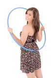 Young attractive woman holding hula hoop Royalty Free Stock Photo