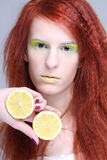 Young attractive woman holding lemon Stock Photo