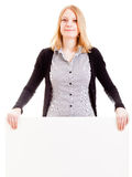 Young attractive woman holding sign Stock Photography