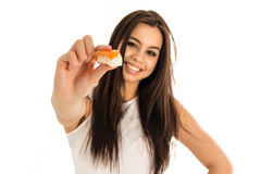 Young attractive woman holding sushi with her Royalty Free Stock Photos
