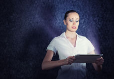 Young attractive woman holding a tablet Stock Photography