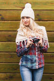 Young attractive woman holds old camera Royalty Free Stock Photo