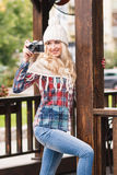Young attractive woman holds old camera Stock Image
