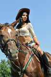 Young attractive woman horseback riding Stock Images