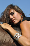 Young attractive woman horseback riding. In the summer sunny day Royalty Free Stock Photos