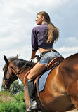 Young attractive woman horseback riding Royalty Free Stock Photo