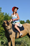 Young attractive  woman horseback riding Royalty Free Stock Images