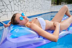 Young Attractive Woman In  In Pool Royalty Free Stock Photos