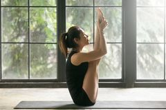 Young Attractive Woman In Urdhva Mukha Paschimottanasana Pose, W Royalty Free Stock Images
