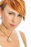 Young woman with intense green eyes. Young attractive woman with intense green eyes Stock Photo