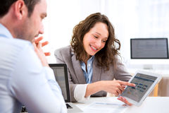 Young attractive woman during job interview Royalty Free Stock Photos