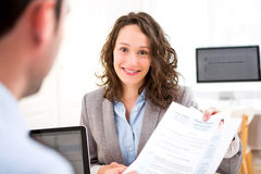 Young attractive woman during job interview Royalty Free Stock Images