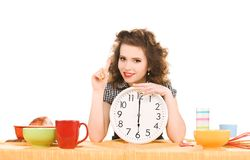 Young attractive woman in the kitchen Royalty Free Stock Photos