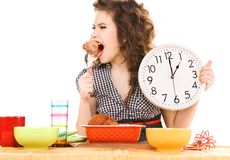 Young attractive woman in the kitchen Royalty Free Stock Photography