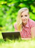 Young attractive woman with laptop. Stock Images