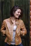 Young attractive woman in a leather jacket in the fall Stock Photo