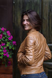 Young attractive woman in a leather jacket in the fall Stock Photography