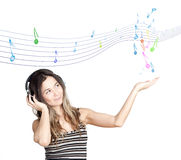 Young attractive woman listing to music Royalty Free Stock Photos