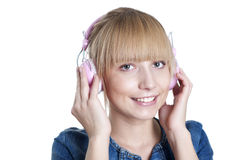 Young attractive woman listing to music Stock Images