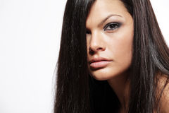 Young attractive woman with long black hair. Stock Photo