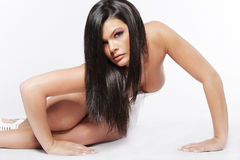 Young attractive woman with long black hair. royalty free stock image