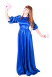 Young attractive woman in a long blue evening dress Royalty Free Stock Photo