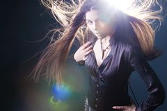 Young attractive woman with long hair like a witch. Femme brunette, mystical fantasy style royalty free stock photo