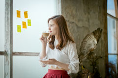 Young attractive woman looking away thoughtfully . Royalty Free Stock Photo