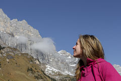 Young Woman Looking at Mountains Stock Images