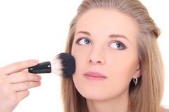 Young attractive woman with make-up brush over white Stock Images