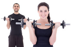 Young attractive woman and man doing exercises with dumbbells is Stock Photo