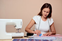 Young attractive woman mark out fabric Stock Image