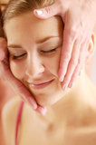 The young attractive woman during massage of face Royalty Free Stock Photography
