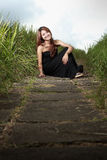 Young attractive woman in meadow Royalty Free Stock Photography