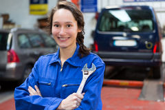 Young attractive woman mechanic working at the garage Stock Image