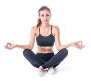 Young attractive woman meditates Stock Images