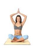 Young and attractive woman meditating Stock Images