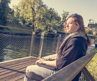 Young and attractive woman meditating with closed laptop. Royalty Free Stock Photo