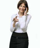 A young attractive woman on mobile phone. Portrait of a young attractive talking woman Stock Photos