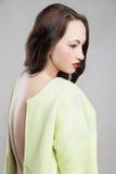 Young attractive woman in morden coat Stock Photo